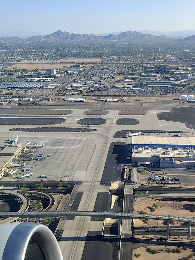 An aerial picture of PHX Sky Harbor International Airport from an airplane taking off